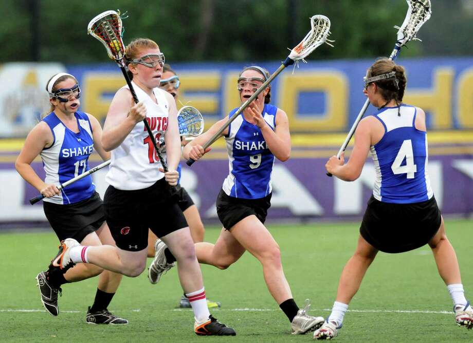 Guilderland's Carli Weinberg, second from left, carries the ball during their Section II Class A final against Shaker on Thursday, May 23, 2013, at UAlbany in Albany, N.Y. (Cindy Schultz / Times Union) Photo: Cindy Schultz / 00022486A