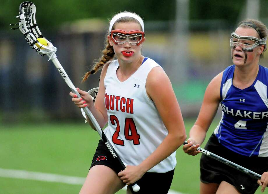 Guilderland's Rebecca Golderman, left, carries the ball as Shaker's Sarah Cheney defends during their Section II Class A final on Thursday, May 23, 2013, at UAlbany in Albany, N.Y. (Cindy Schultz / Times Union) Photo: Cindy Schultz / 00022486A