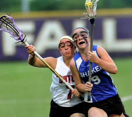 Shaker's Julie Lennon, right, carries the ball as Guilderland's Jenna Walsh defends during their Section II Class A final on Thursday, May 23, 2013, at UAlbany in Albany, N.Y. (Cindy Schultz / Times Union) Photo: Cindy Schultz / 00022486A