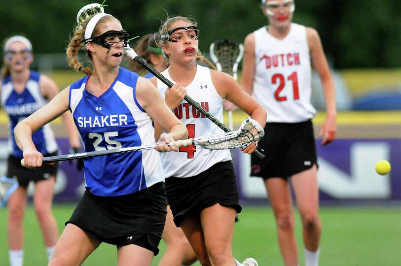 Shaker's Ela Torncello, left, and Guilderland's Ali Cardinal, center, chase a loose ball during thei