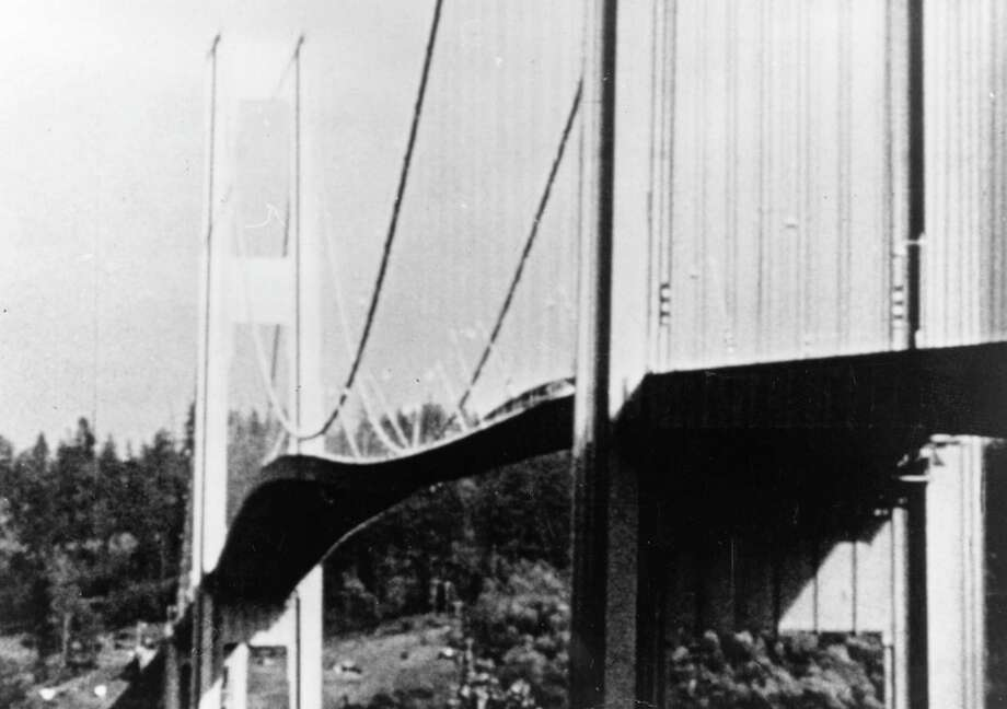 1940:  The Tacoma Narrows suspension bridge over the Puget Sound in Washington collapsed after high winds created the violent oscillating motion of the roadbed. A dog named Tubby was killed. Photo: Keystone, File / Hulton Archive