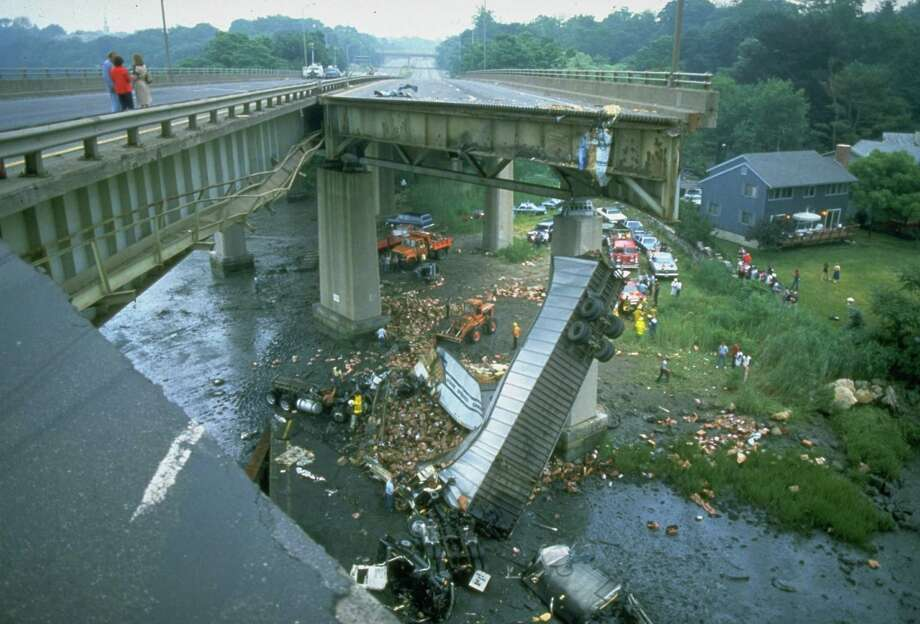 Twisted tractor trailer truck lies 70 feet below collapsed section of Mianus River bridge on I-95.  (Photo by Hank Morgan//Time Life Pictures/Getty Images) Photo: Hank Morgan, File / Hank Morgan