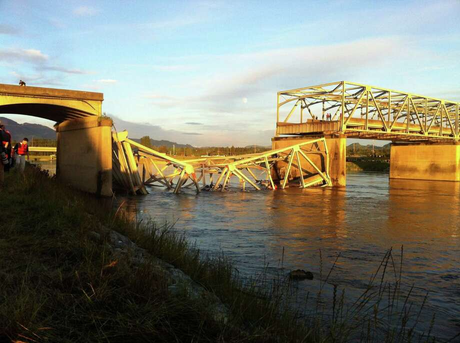 A portion of the Interstate 5 bridge is submerged after it collapsed into the Skagit River dumping vehicles and people into the water in Mount Vernon, Wash., Thursday, May 23, 2013 according to the Washington State Patrol. Photo: AP