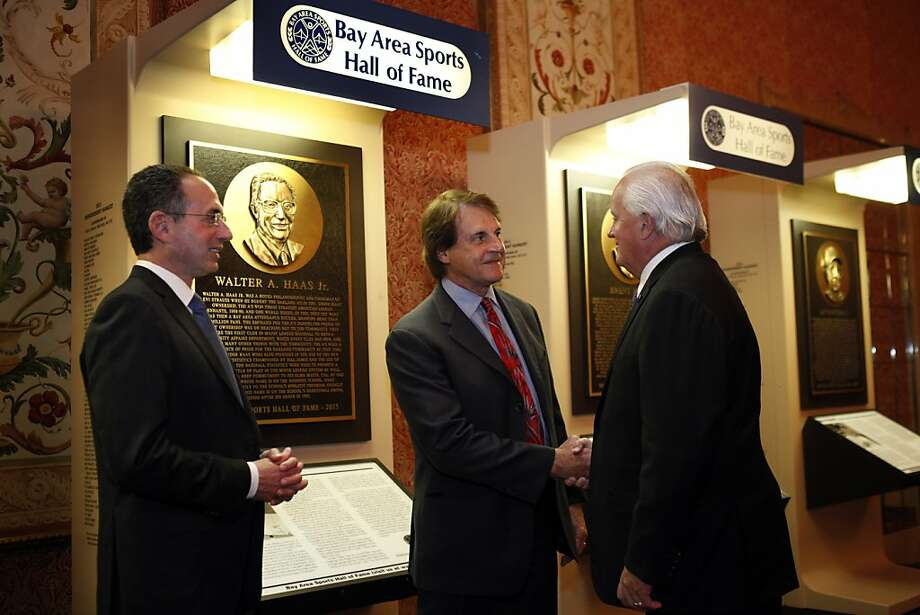 Tony LaRussa, center, shakes hands with Kevin O'Brien (president and CEO of BASHOF, as Wally Haas watches in front of the plaque honoring Haas's father Walter A. Haas, Jr. Bay Area sports notables gathered at the Westin St. Francis to honor the newest inductees into the Bay Area Sports Hall of Fame in San Francisco, Calif., on Thursday, May 23, 2013. New inductees include Tim Brown of the Raiders, Dave Righetti of the Giants, Walter A. Haas, Jr., and Brent Jones of the 49ers. Photo: Carlos Avila Gonzalez, The Chronicle