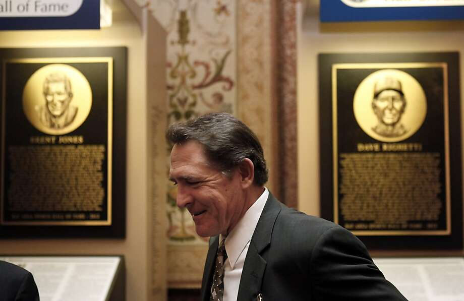 Dave Righetti of the Giants stands before his plaque and that of Walter A. Haas, Jr., before induction ceremonies on Thursday. Bay Area sports notables gathered at the Westin St. Francis to honor the newest inductees into the Bay Area Sports Hall of Fame in San Francisco, Calif., on Thursday, May 23, 2013. New inductees include Tim Brown of the Raiders, Dave Righetti of the Giants, Walter A. Haas, Jr., and Brent Jones of the 49ers. Photo: Carlos Avila Gonzalez, The Chronicle