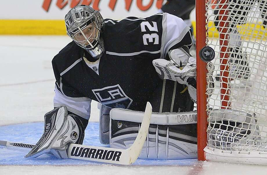 Los Angeles Kings goalie Jonathan Quick (32) deflects a shot during the third period against the San Jose Sharks in Game 5 of the Western Conference semifinals in the NHL hockey Stanley Cup playoffs, Thursday, May 23, 2013, in Los Angeles.  (AP Photo/Mark J. Terrill) Photo: Mark J. Terrill, Associated Press