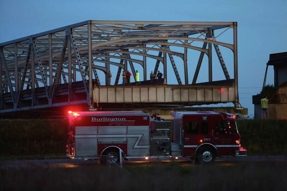 Crews look over the edge after an Interstate 5 bridge collapsed over the Skagit River between Mt. Vernon and Burlington on Thursday, May 23, 2013. Two cars and one travel trailer went in the water. There were no known fatalities. Photo: JOSHUA TRUJILLO, SEATTLEPI.COM / SEATTLEPI.COM