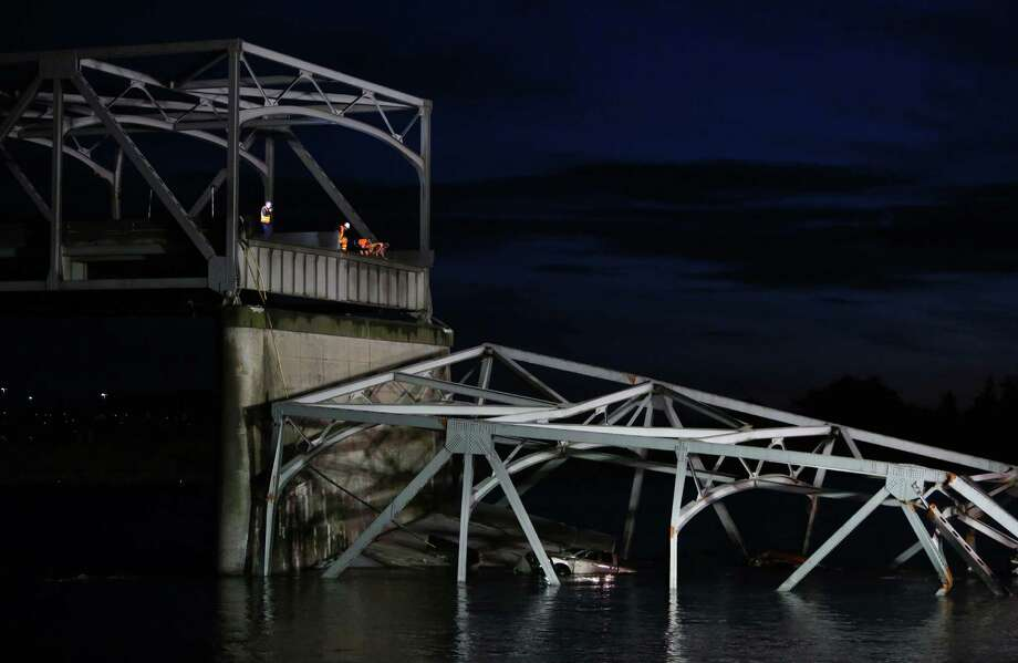 Engineers look over the scene after an Interstate 5 bridge collapsed over the Skagit River between Mt. Vernon and Burlington on Thursday, May 23, 2013. Two cars and one travel trailer went in the water. There were no known fatalities. Photo: JOSHUA TRUJILLO, SEATTLEPI.COM / SEATTLEPI.COM