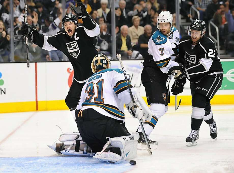 The Los Angeles Kings' Dustin Brown, top left, celebrates a goal by teammate Slava Voynov, not pictured, in front of San Jose Sharks goalie Antti Niemi (31) in the third period in Game 5 of the Western Conference semifinals at Staples Center in Los Angeles, California, on Thursday, May 23, 2013. (Wally Skalij/Los Angeles Times/MCT) Photo: Wally Skalij, McClatchy-Tribune News Service