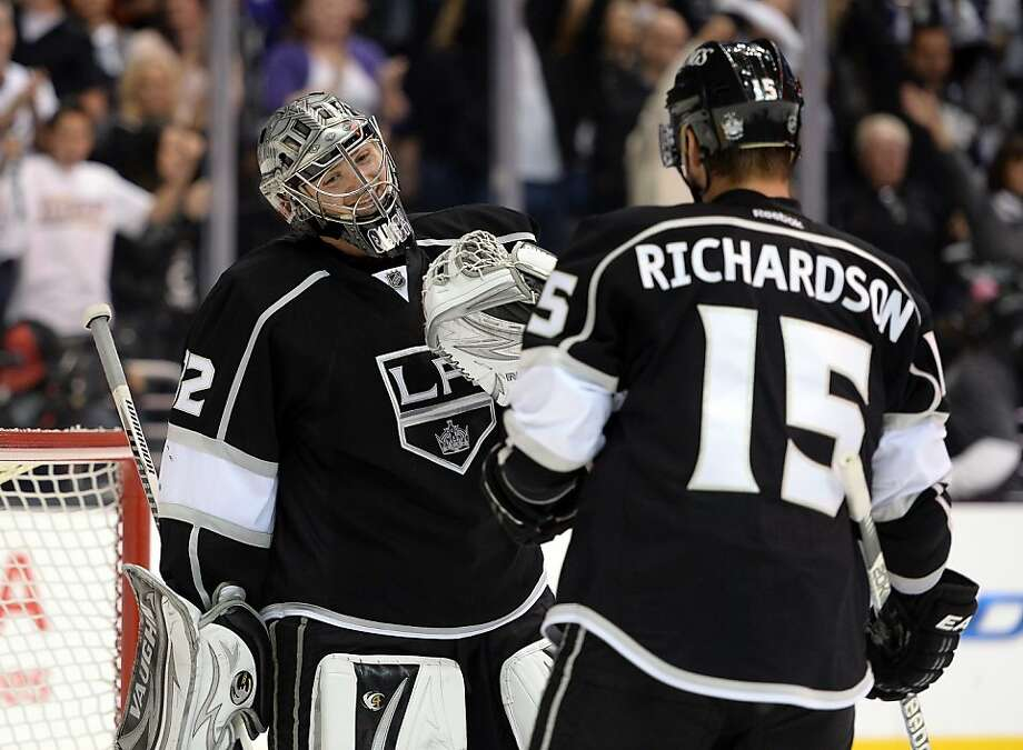 LOS ANGELES, CA - MAY 23:  Jonathan Quick #32 of the Los Angeles Kings celebrates a 3-0 shutout win over the San Jose Sharks with Brad Richardson #15 to take a 3-2 series lead in Game Five of the Western Conference Semifinals during the 2013 Stanley Cup Playoffs at Staples Center on May 23, 2013 in Los Angeles, California.  (Photo by Harry How/Getty Images) Photo: Harry How, Getty Images