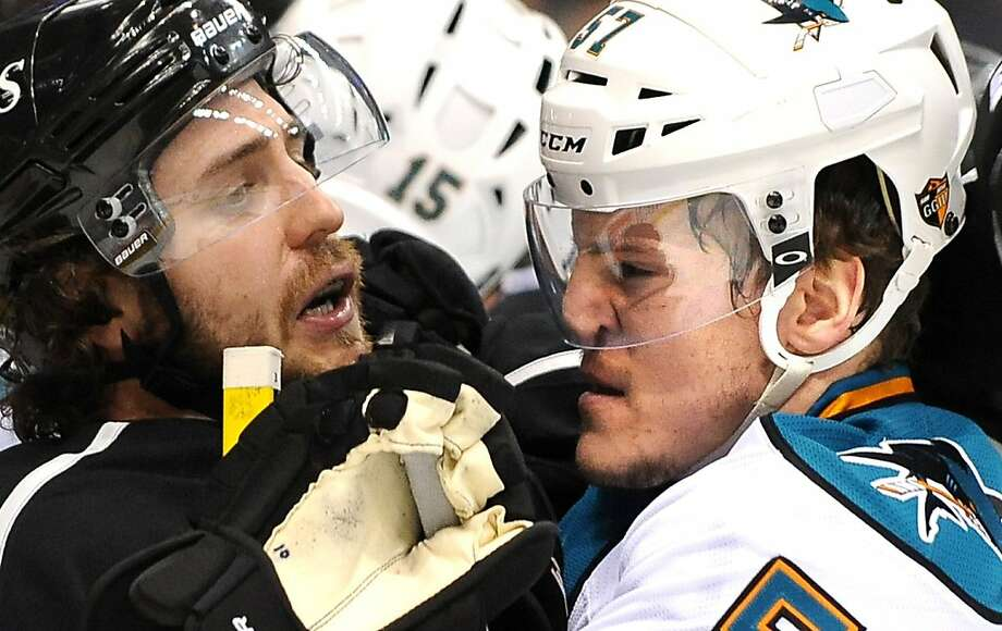The Los Angeles Kings' Mike Richards, left, and the San Jose Sharks' Tommy Wingels scuffle in the first period in Game 5 of the Western Conference semifinals at Staples Center in Los Angeles, California, on Thursday, May 23, 2013. (Wally Skalij/Los Angeles Times/MCT) Photo: Wally Skalij, McClatchy-Tribune News Service