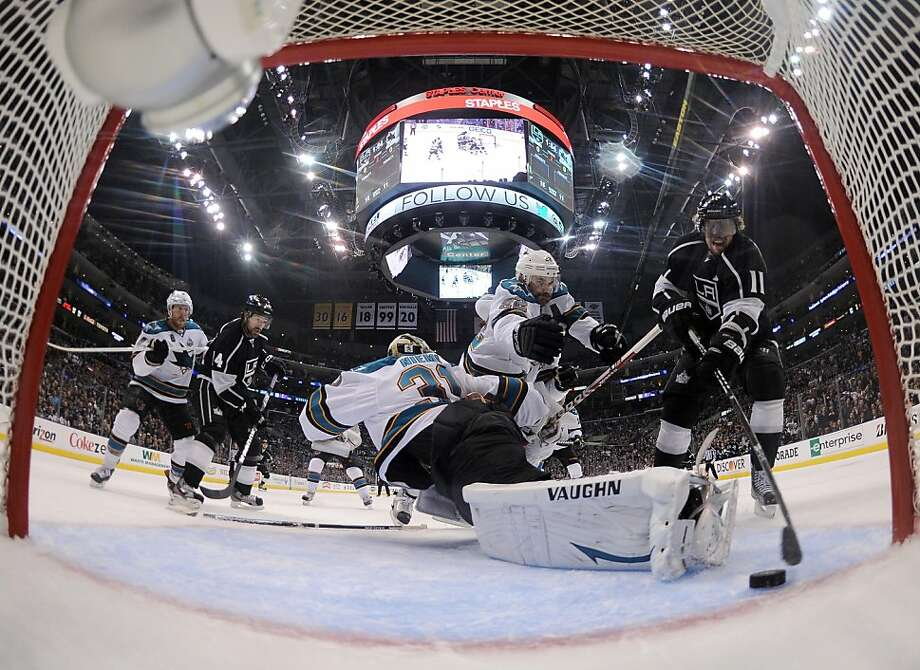 LOS ANGELES, CA - MAY 23:  Anze Kopitar #11 of the Los Angeles Kings scores a goal past Antti Niemi #31 of the San Jose Sharks and in front of Dan Boyle #22 to take a 1-0 lead during the second period in Game Five of the Western Conference Semifinals during the 2013 Stanley Cup Playoffs at Staples Center on May 23, 2013 in Los Angeles, California.  (Photo by Harry How/Getty Images) Photo: Harry How, Getty Images