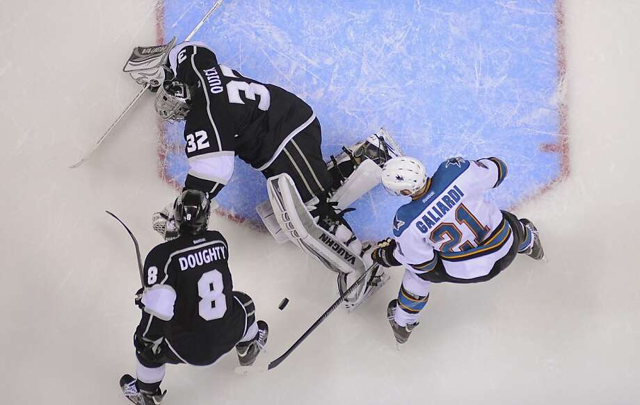 Los Angeles Kings goalie Jonathan Quick (32) blocks a shot attempt by San Jose Sharks left wing T.J. Galiardi (21) as Los Angeles Kings defenseman Drew Doughty (8) helps defend in the third period during Game 5 of the Western Conference semifinals in the NHL hockey Stanley Cup playoffs, Thursday, May 23, 2013, in Los Angeles. The Kings won 3-0. (AP Photo/Mark J. Terrill) Photo: Mark J. Terrill, Associated Press
