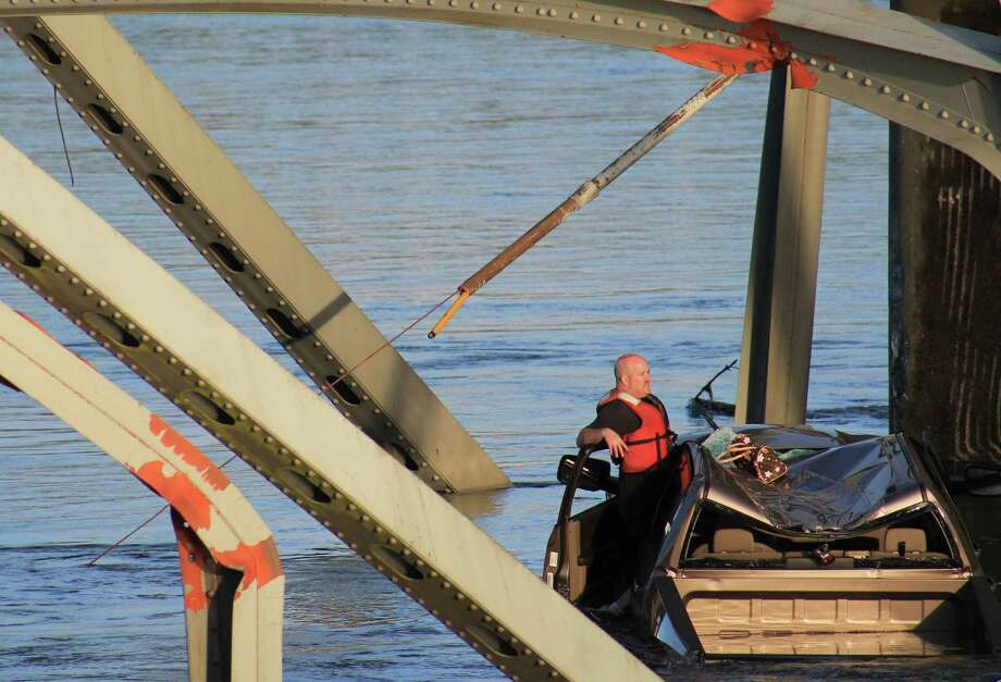 A man sits in his truck after an Interstate 5 bridge collapsed over the Skagit River between Mt. Vernon and Burlington on Thursday, May 23, 2013. Two cars and one travel trailer went in the water. There were no known fatalities. Photo: Francisco Rodriguez, Special To Seattlepi.com / special to seattlepi.com
