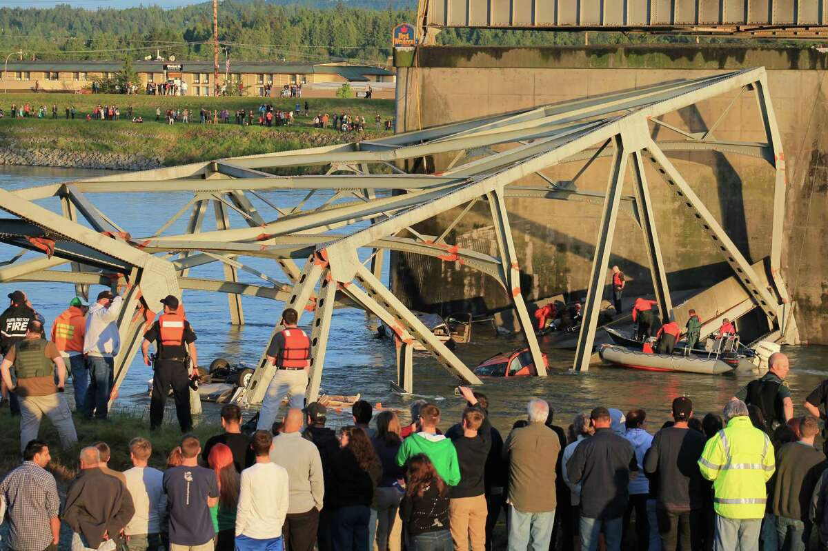 Rescue crews work the scene after an Interstate 5 bridge collapsed over the Skagit River between Mt. Vernon and Burlington on Thursday, May 23, 2013. Two cars and one travel trailer went in the water. There were no known fatalities.