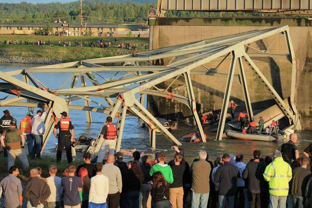 Rescue crews work the scene after an Interstate 5 bridge collapsed over the Skagit River between Mt. Vernon and Burlington on Thursday, May 23,
