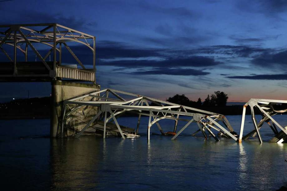 The sun sets after an Interstate 5 bridge collapsed over the Skagit River between Mt. Vernon and Burlington on Thursday, May 23, 2013. Two cars and one travel trailer went in the water. There were no know nfatalities. Photo: JOSHUA TRUJILLO, SEATTLEPI.COM / SEATTLEPI.COM