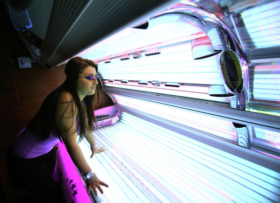 A Connecticut bill banning young people from using indoor tanning services is moving to the governor's desk. The state House of Representatives on Thursday, May 23, 2013, voted 117-21, to pass legislation forbidding anyone under age 17 from using an indoor tanning device.  Currently, people under age 16 must receive written parental consent to receive tanning services. This proposal would eliminate the exception for parental consent. Photo: Brian A. Pounds / Connecticut Post