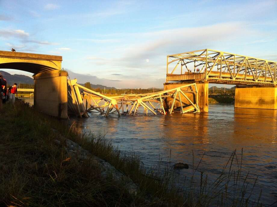 A portion of the Interstate 5 bridge is submerged after it collapsed into the Skagit River dumping vehicles and people into the water in Mount Vernon, Wash., Thursday, May 23, 2013 according to the Washington State Patrol. Photo: Frank Varga, Associated Press