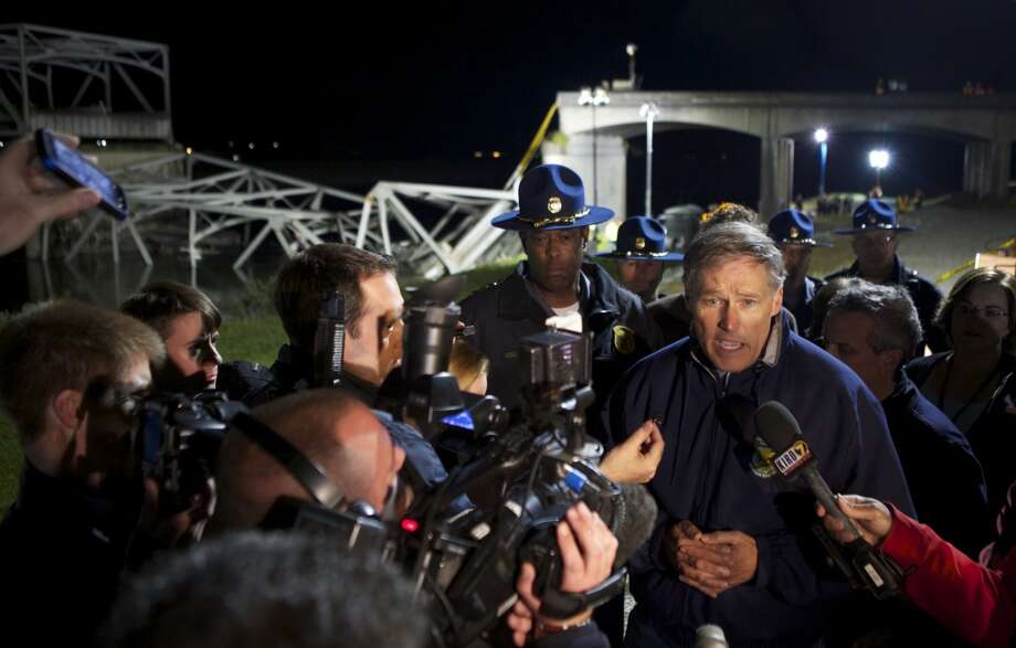 Washington State Governor Jay Inslee addresses the media at the scene of a bridge collapse into the Skagit River on Interstate 5 on May 23, 2013 near Mt. Vernon, Washington. People and cars were thrown into the river when the four-lane bridge collapsed. At least three people were rescued from the water but there have been no reported deaths. Police are investigating witnesses reports that a semi-truck may have struck the bridge causing the collapse. Photo: Stephen Brashear, Getty Images