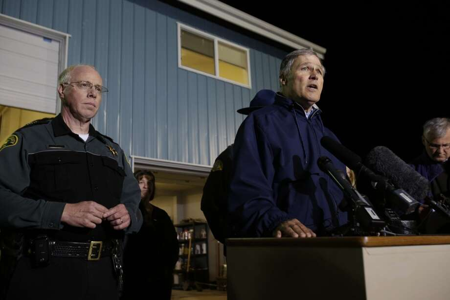 Washington Governor Jay Inslee, right, talks to reporters about the failure of the Interstate highway bridge crossing the Skagit River in Mt. Vernon Thursday May 23, 2013, dumping two vehicles into the water and sparking a rescue effort by boats and divers as three injured people were pulled from the chilly waterway. Early reports indicate this semi trailier may have struck the bridge. Photo: DEAN RUTZ, Associated Press