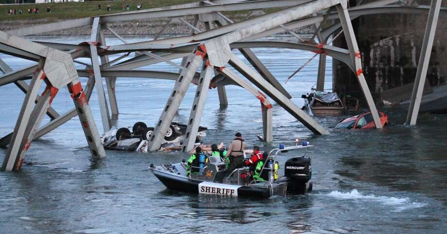 In this photo provided by Francisco Rodriguez, a rescue boat approaches the scene where a pickup truck and travel trailer, seen at left, and a car fell into the Skagit River after the collapse of the Interstate 5 bridgeThursday, May 23, 2013, in Mount Vernon, Wash. Photo: Francisco Rodriguez, Associated Press