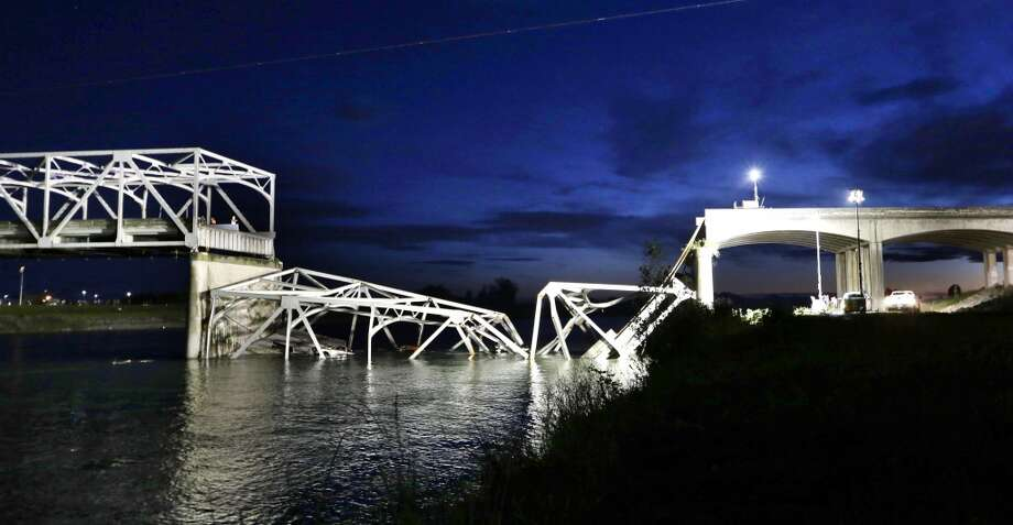 The collapsed Interstate-5 bridge is seen at dusk submerged after collapsing into the Skagit River, dumping vehicles and people into the water, in Mount Vernon, Wash., Thursday, May 23, 2013. Photo: Elaine Thompson, Associated Press