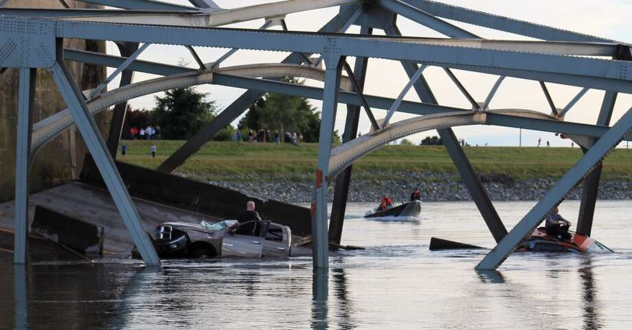 In this photo provided by Francisco Rodriguez, a rescue boat approaches the scene where a pickup truck and a car fell into the Skagit River after the collapse of the Interstate 5 bridgeThursday, May 23, 2013, in Mount Vernon, Wash. Photo: Francisco Rodriguez, Associated Press