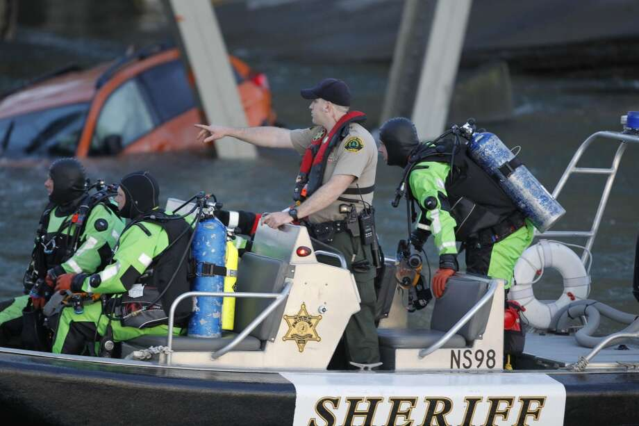A rescue boat and divers search near a portion of the Interstate-5 bridge that is submerged after it collapsed into the Skagit river dumping vehicles and people into the water in Mount Vernon, Wash., Thursday, May 23, 2013 according to the Washington State Patrol. Photo: Joe Nicholson, Associated Press