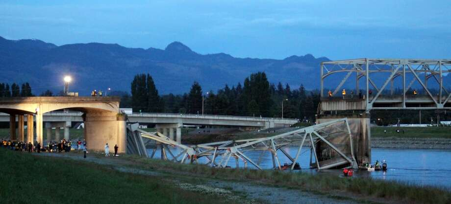 In this photo provided by Francisco Rodriguez, the scene were the Interstate 5 bridge collapsed into the Skagit River is seen at dusk Thursday, May 23, 2013, in Mount Vernon, Wash. Photo: Francisco Rodriguez, Associated Press