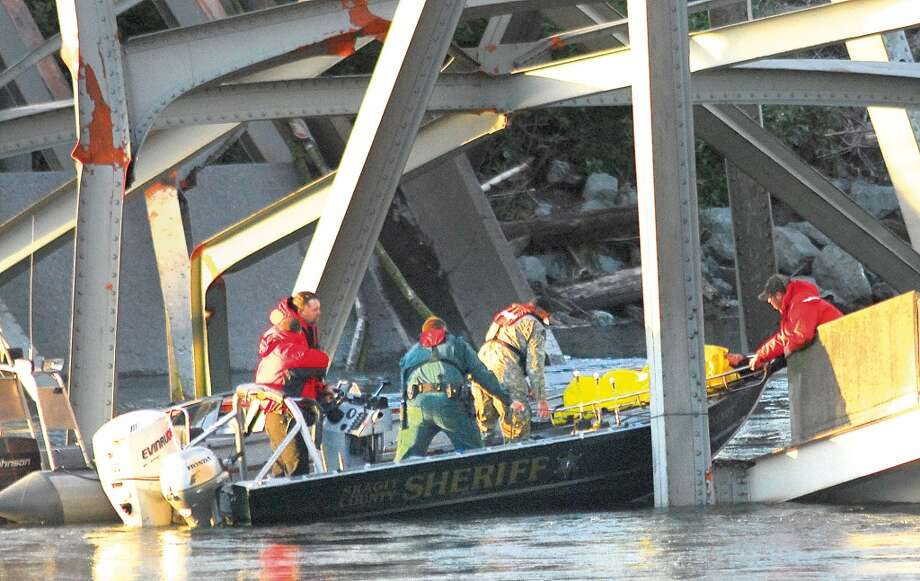 A person is removed from the wreckage of the collapsed Interstate-5 bridge in Mount Vernon, Wash. Thursday May 23, 2012. The Interstate 5 bridge over the Skagit river collapsed north of Seattle Thursday evening, dumping two vehicles into the water and sparking a rescue effort by boats and divers as three injured people were pulled from the chilly waterway. Photo: Frank Varga, Associated Press