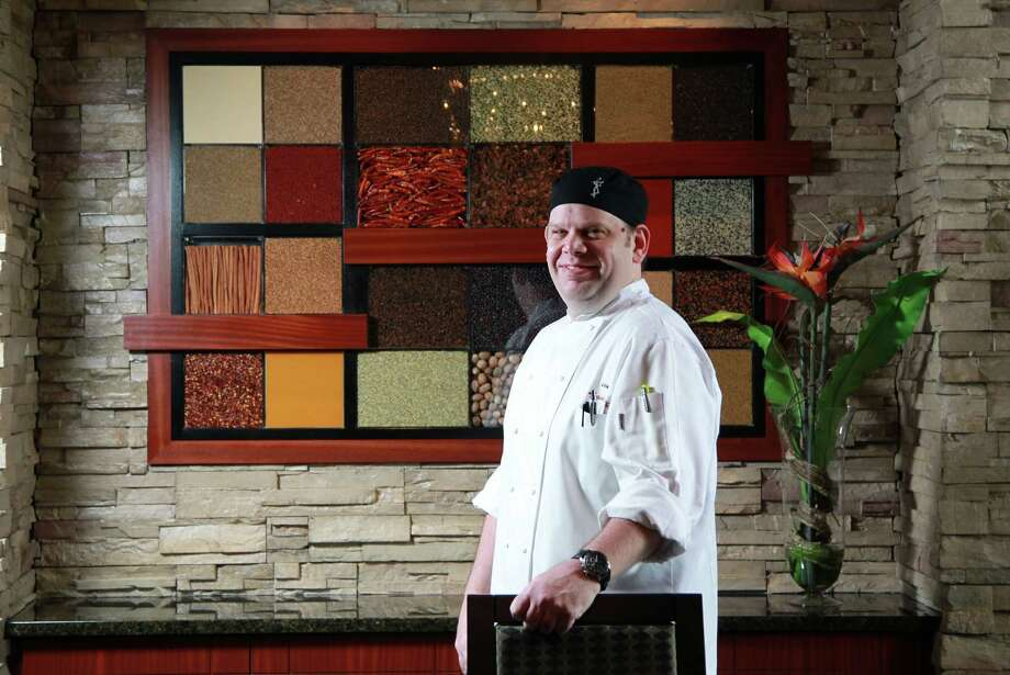 """Seasons 52Chef James Holets, who previously worked for Landry's and other restaurants across the country, helms the kitchen at new Seasons 52 restaurant.Holets is no stranger to Houston, but a lot has changed in the eight years since he's lived here.""""It's exciting to be back,"""" he said. """"The food scene has always been  here because of the population. The living scene here is the whole  package.""""One thing you may not know about Holets:""""I know all the Texans fans may want to turn their heads, but I'm a huge Pittsburgh Steelers fan."""" Photo: Mayra Beltran, Staff / © 2013 Houston Chronicle"""