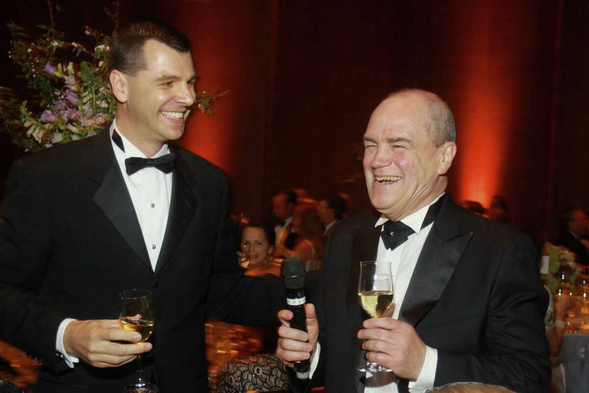 Mark Hanson, left, with Hans Graf, the symphony's departing music director