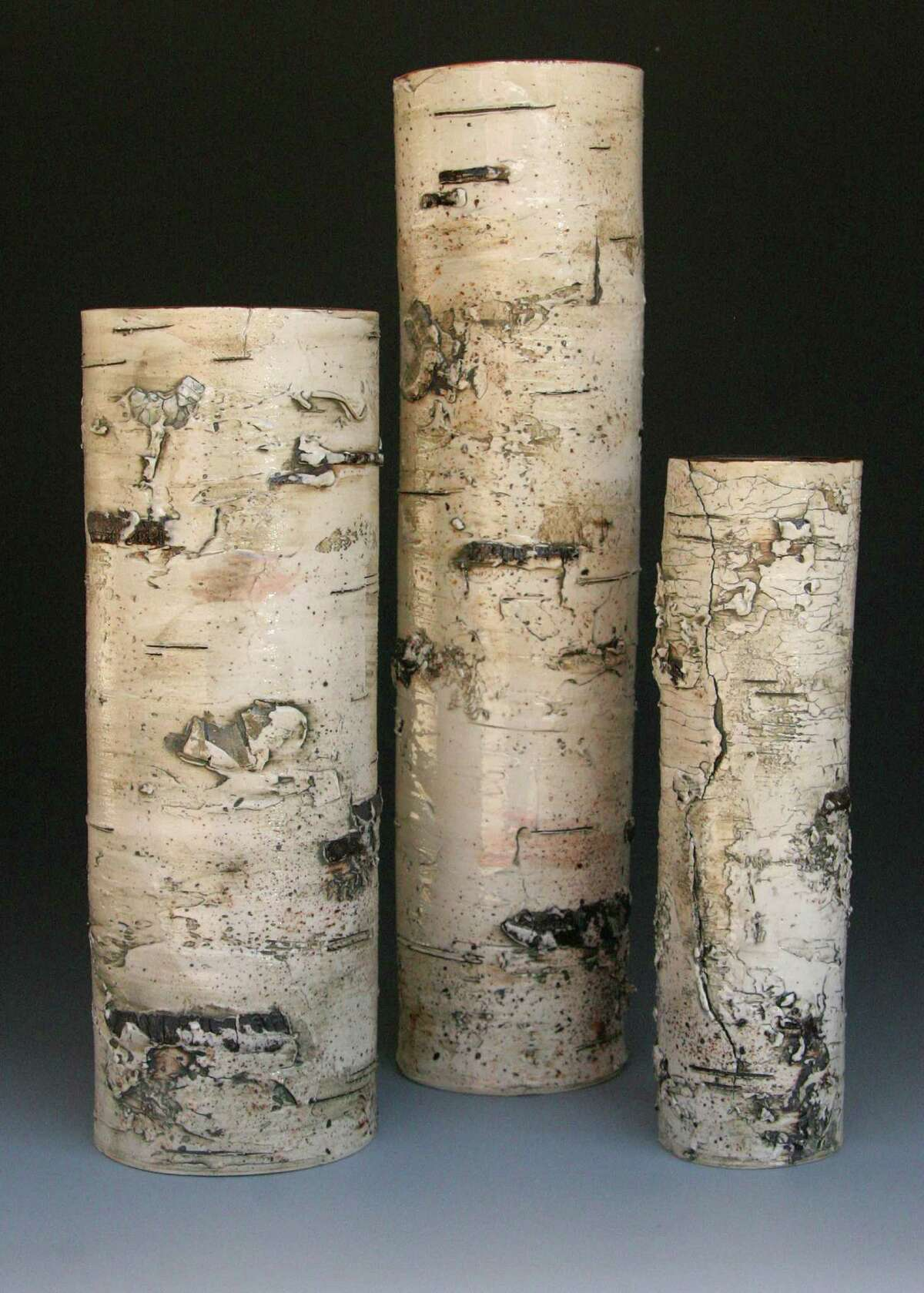 Michigan artist Elizabeth Delyria's stoneware vases look so much like actual birch logs that viewers might have to see the smooth, hollow interior to believe they're not actually wood; $TK at Asher Gallery in the Houston Center for Contemporary Craft.