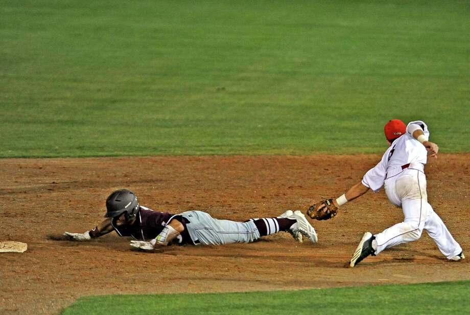 Silsbee player Adam Valencia, #8, slides safely into second during the Silsbee High School regional semi final baseball game against Carthage High School.  Silsbee won over Carthage 4 - 1. Photo taken: Randy Edwards/The Enterprise Photo: Randy Edwards