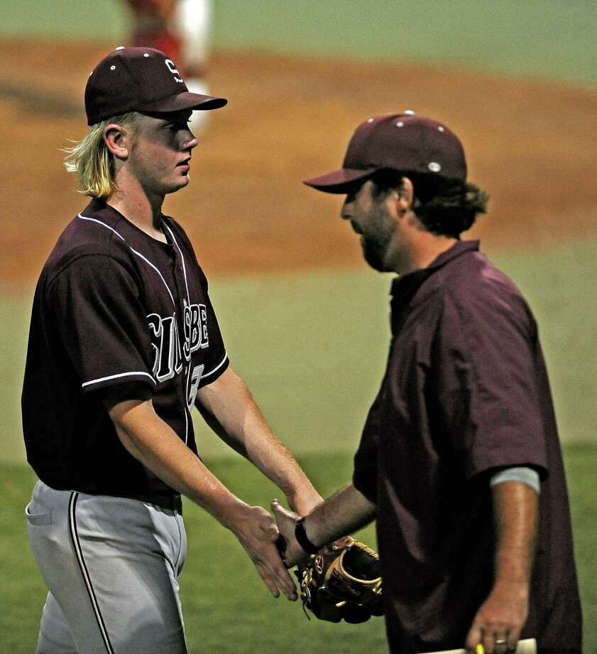 Silsbee coach Michael Nelson, right, congrats pitcher Tyler Powell after an inning of saves during the Silsbee High School regional semi final baseball game against Carthage High School.  Silsbee won over Carthage 4 - 1. Photo taken: Randy Edwards/The Enterprise Photo: Randy Edwards