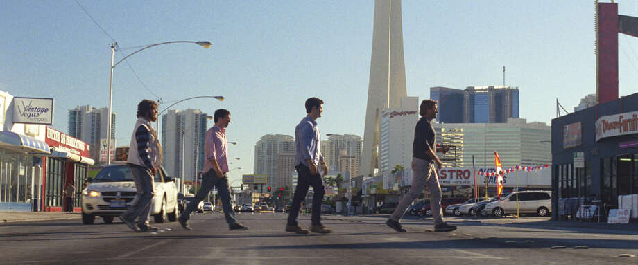 """The Wolf Pack - Alan (Zach Galifianakis, from left), Stu (Ed Helms) Doug (Justin Bartha) and Phil (Bradley Cooper) - find themselves battling mobsters in Las Vegas in """"Hangover Part III."""" Photo: Courtesy Warner Bros. Pictures"""