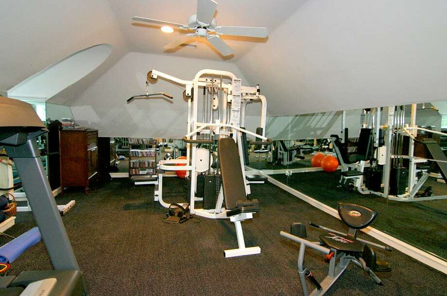 No need to join a gym when you have this extensive fitness room in your own home! Photo: HAR.com
