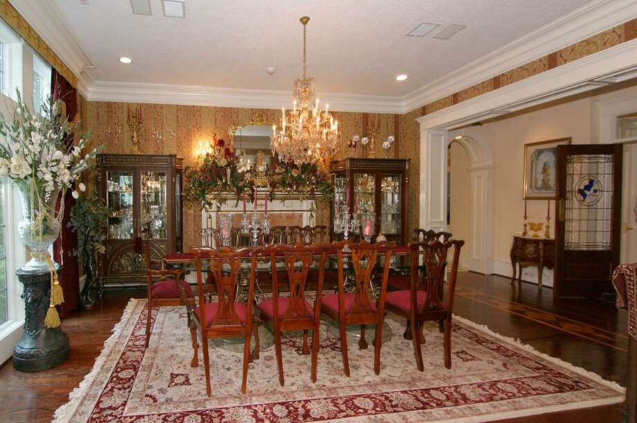 Diners may evoke romance or revelry in this beautifully appointed dining room - complete with its own private fireplace! A 16 person dining table fits easily for large scale entertainment. Photo: HAR.com