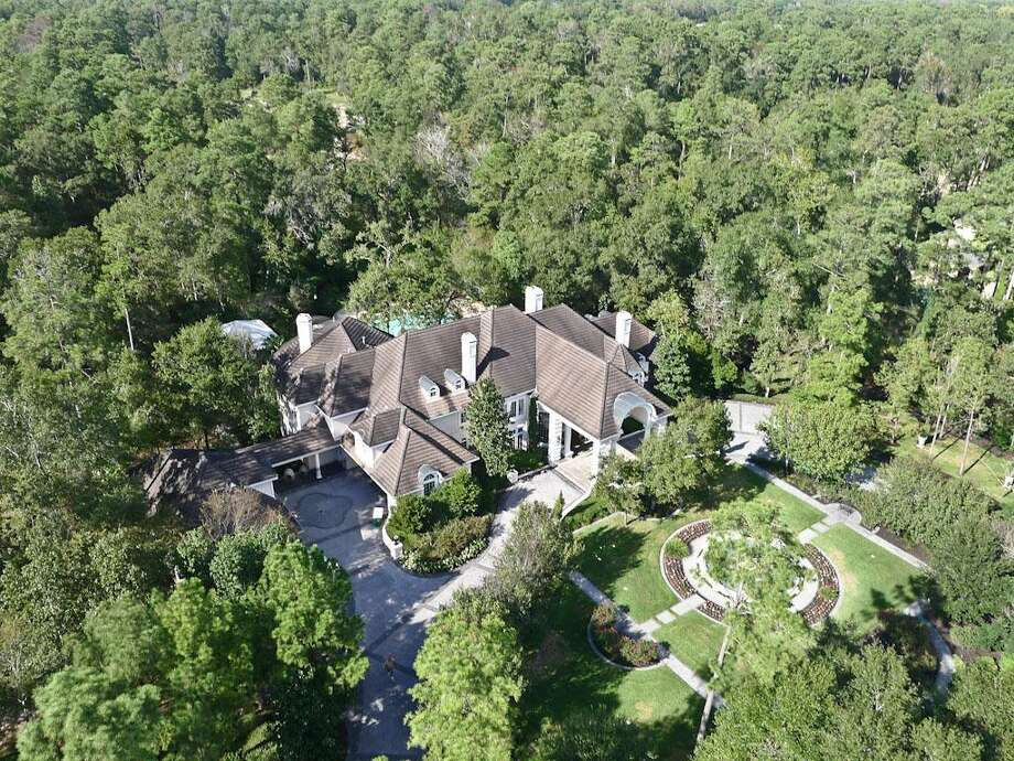 205 Grogans Point Road, The WoodlandsThis home was originally listed for $5.4 million, but the price has been cut by more than $402,000. The asking price is now $5 million. Photo: HAR.com