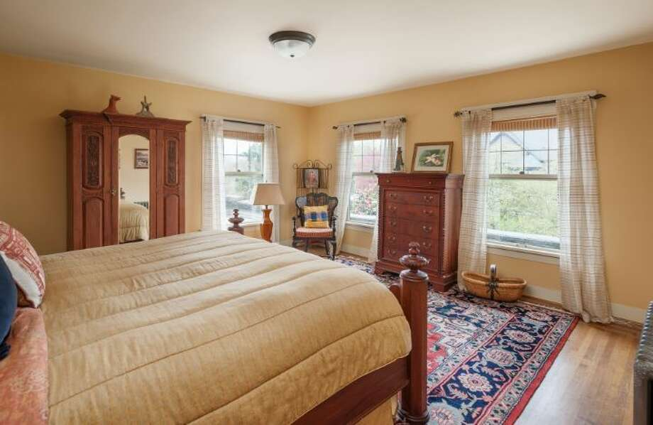 Bedroom of 1114 21st Ave. E. The 5,820-square-foot house, built in 1912, has six bedrooms, five bathrooms, three fireplaces, a family room, his and her offices, a game room, a porch, a deck, a patio, a carport and a garage on an 8,640-square-foot lot. It's listed for $2.595 million. Photo: Courtesy Catherine Adams, Windermere Real Estate