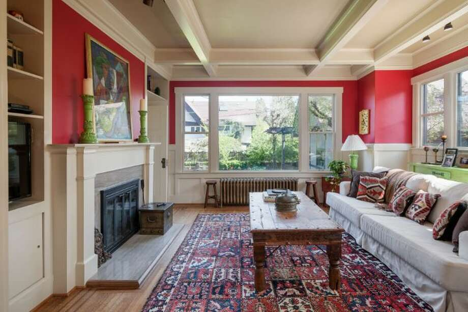 Family room of 1114 21st Ave. E. The 5,820-square-foot house, built in 1912, has six bedrooms, five bathrooms, three fireplaces, his and her offices, a game room, a porch, a deck, a patio, a carport and a garage on an 8,640-square-foot lot. It's listed for $2.595 million. Photo: Courtesy Catherine Adams, Windermere Real Estate