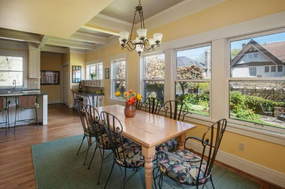 Eating area of 1114 21st Ave. E. The 5,820-square-foot house, built in 1912, has six bedrooms, five bathrooms, three fireplaces, a family room, his and her offices, a game room, a porch, a deck, a patio, a carport and a garage on an 8,640-square-foot lot. It's listed for $2.595 million. Photo: Courtesy Catherine Adams, Windermere Real Estate