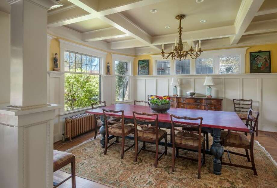 Dining room of 1114 21st Ave. E. The 5,820-square-foot house, built in 1912, has six bedrooms, five bathrooms, three fireplaces, a family room, his and her offices, a game room, a porch, a deck, a patio, a carport and a garage on an 8,640-square-foot lot. It's listed for $2.595 million. Photo: Courtesy Catherine Adams, Windermere Real Estate
