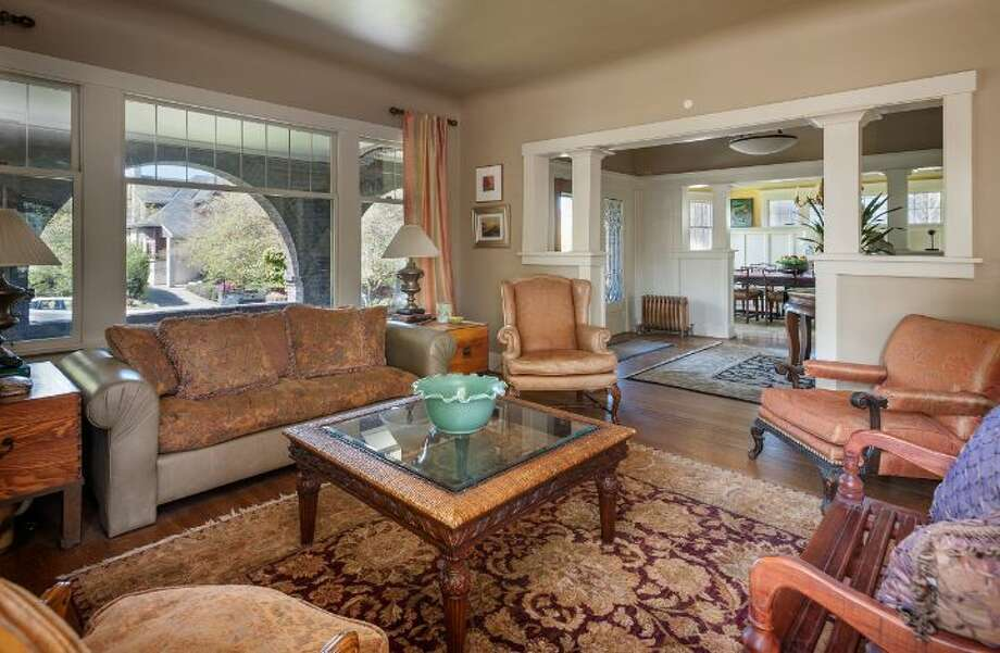 Living room of 1114 21st Ave. E. The 5,820-square-foot house, built in 1912, has six bedrooms, five bathrooms, three fireplaces, a family room, his and her offices, a game room, a porch, a deck, a patio, a carport and a garage on an 8,640-square-foot lot. It's listed for $2.595 million. Photo: Courtesy Catherine Adams, Windermere Real Estate