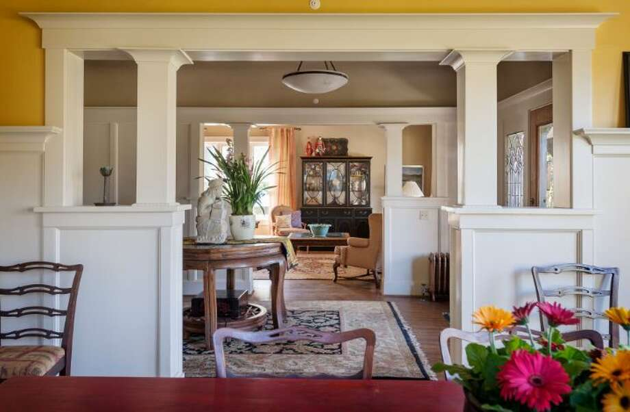 Dining room, looking into entry, of 1114 21st Ave. E. The 5,820-square-foot house, built in 1912, has six bedrooms, five bathrooms, three fireplaces, a family room, his and her offices, a game room, a porch, a deck, a patio, a carport and a garage on an 8,640-square-foot lot. It's listed for $2.595 million. Photo: Courtesy Catherine Adams, Windermere Real Estate