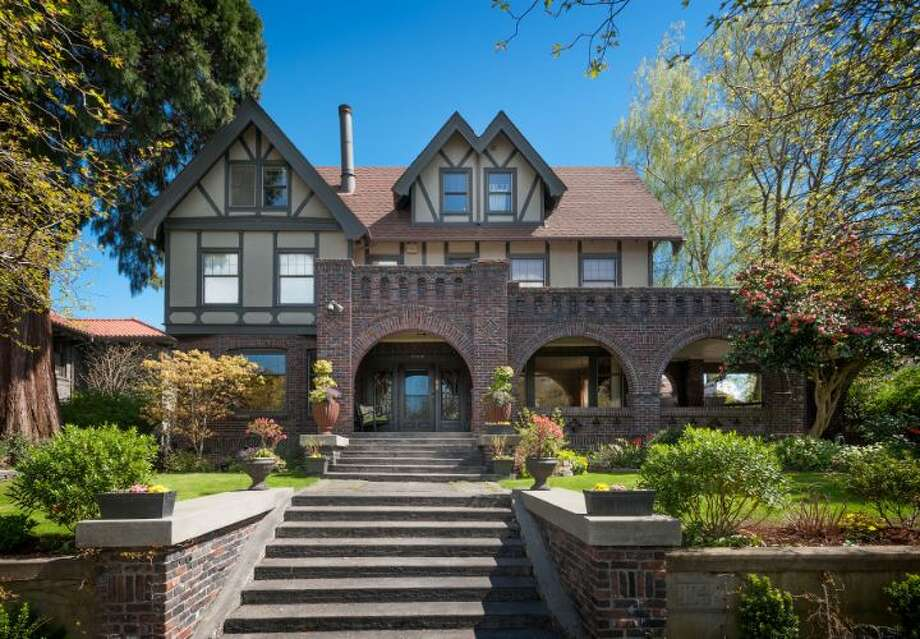 This week's spotlight focuses on a big brick home in Capitol Hill, 1114 21st Ave. E. The 5,820-square-foot house, built in 1912, has six bedrooms, five bathrooms, three fireplaces, a family room, his and her offices, a game room, a porch, a deck, a patio, a carport and a garage on an 8,640-square-foot lot. It's listed for $2.595 million. Photo: Courtesy Catherine Adams,  Windermere Real Estate