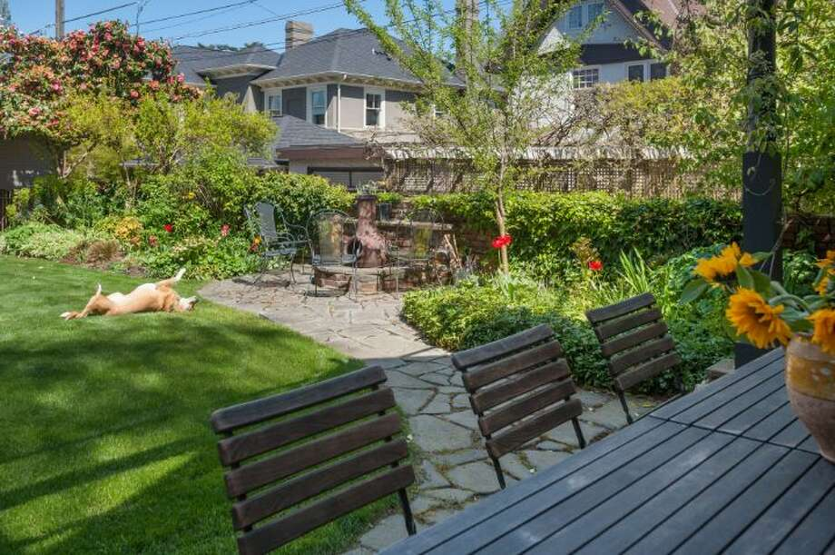 Patio and yard of 1114 21st Ave. E. The 5,820-square-foot house, built in 1912, has six bedrooms, five bathrooms, three fireplaces, a family room, his and her offices, a game room, a porch, a deck, a carport and a garage on an 8,640-square-foot lot. It's listed for $2.595 million. Photo: Courtesy Catherine Adams, Windermere Real Estate