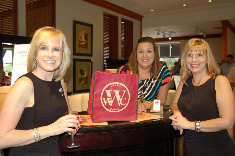 From left, Sarah Raleigh, president and CEO of the Montgomery County Women's Center; Kelly Messenger of Woodlands Wine Co.; and Ally Seder, event chairwoman, enjoy WineFest on Thursday, April 25, at the Macy's Furniture Gallery in The Woodlands Mall.