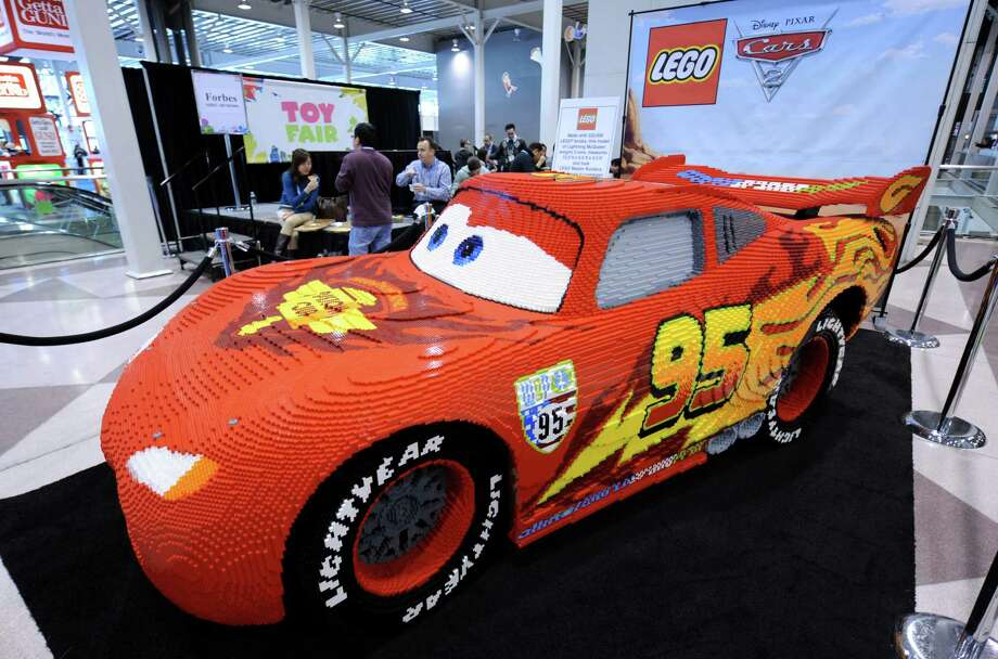 "This model of Lightning McQueen, from the ""Cars"" movies, was 12.5 feet long, weighed 6,000 pounds and was made from 325,000 Lego bricks. It was on display at the Toy Fair 2011 on February 15, 2011 at the Javits Center in New York. Photo: STAN HONDA, AFP/Getty Images / 2011 AFP"